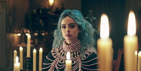 a goth girl with blue hair in nightbooks