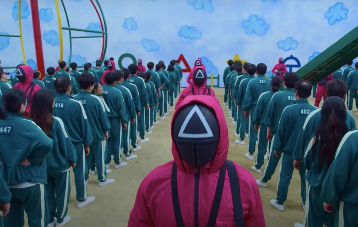 people lined up in matching sweat suits  in squid game
