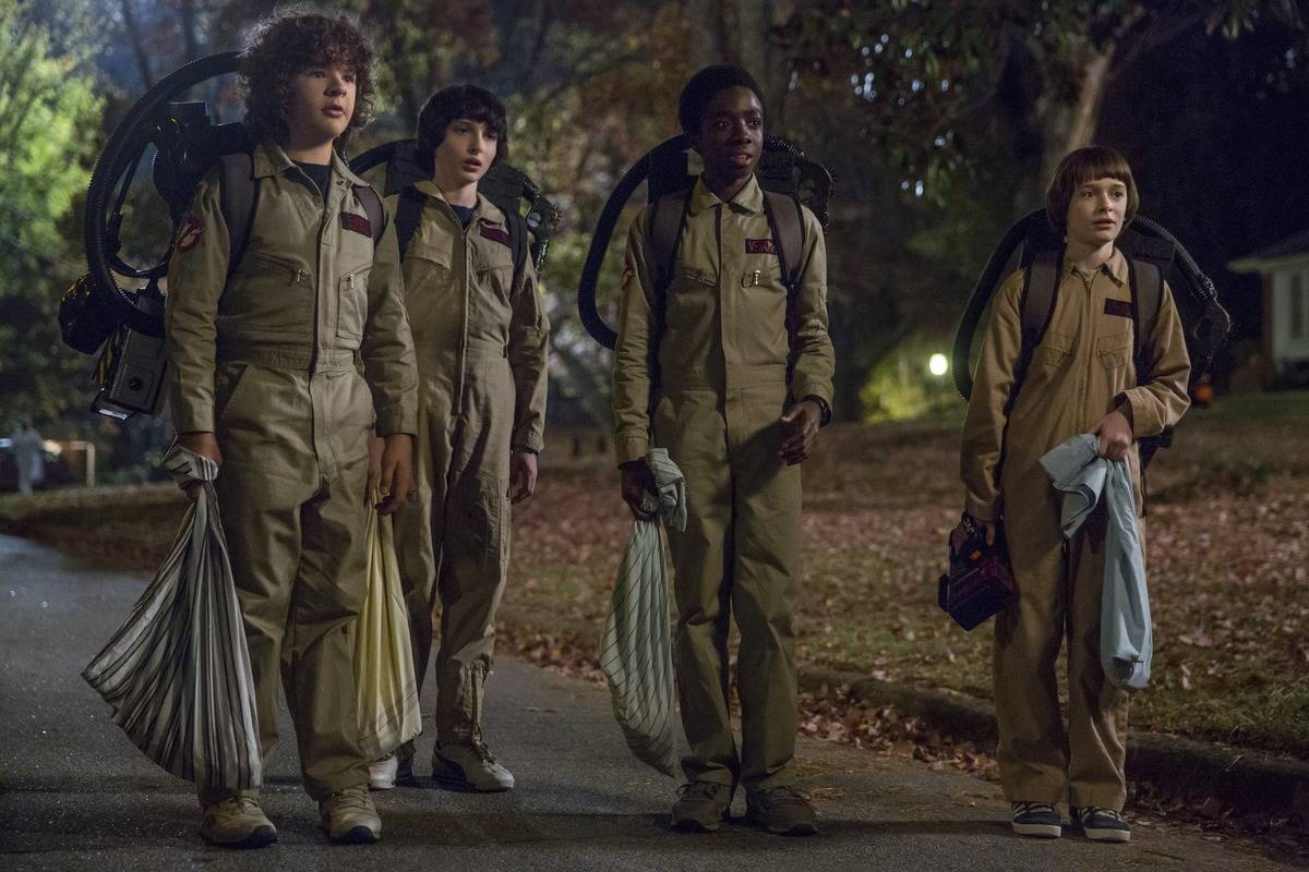 boys from stranger things dressed as ghostbusters