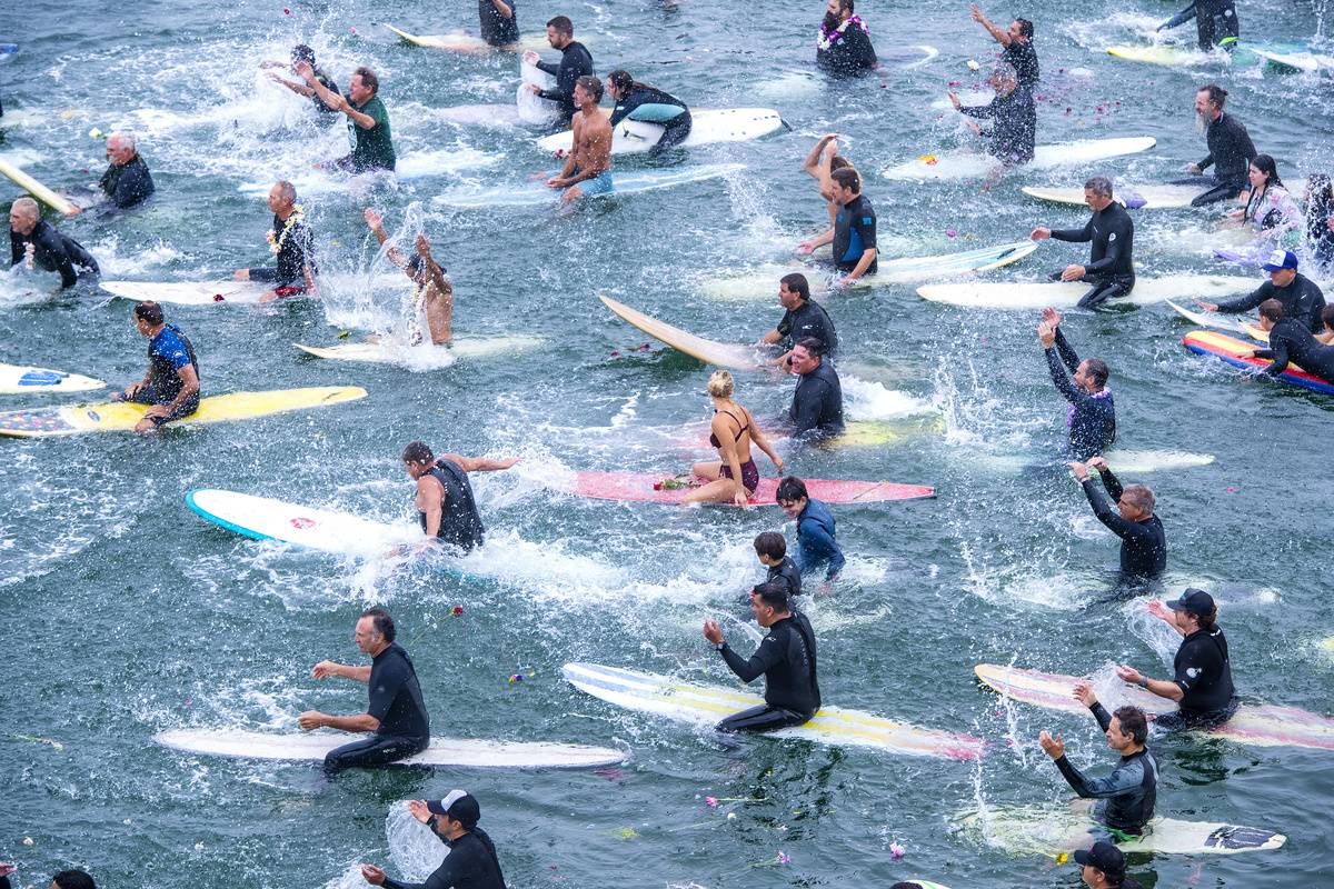 Surf paddle-out memorial held for Huntington Beach's