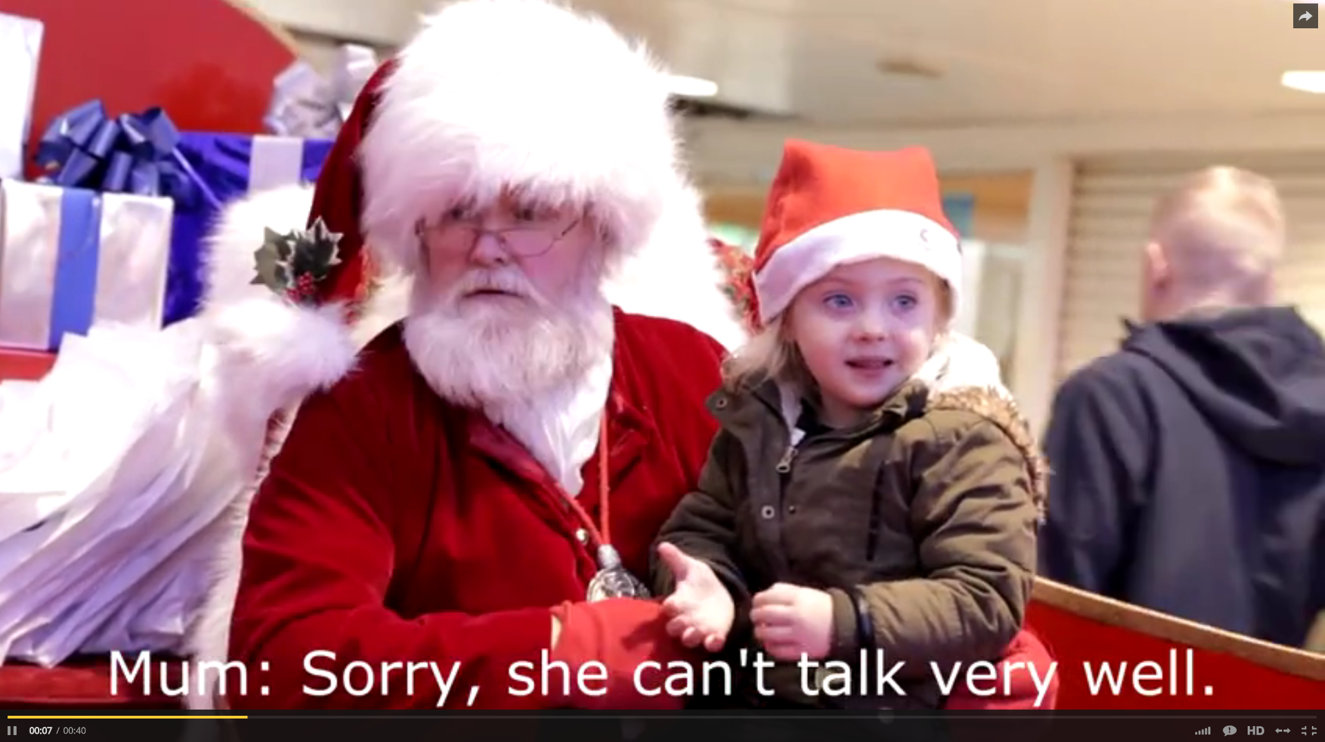 Santa Signs to Child While Mom Watches & Her Reaction is Priceless