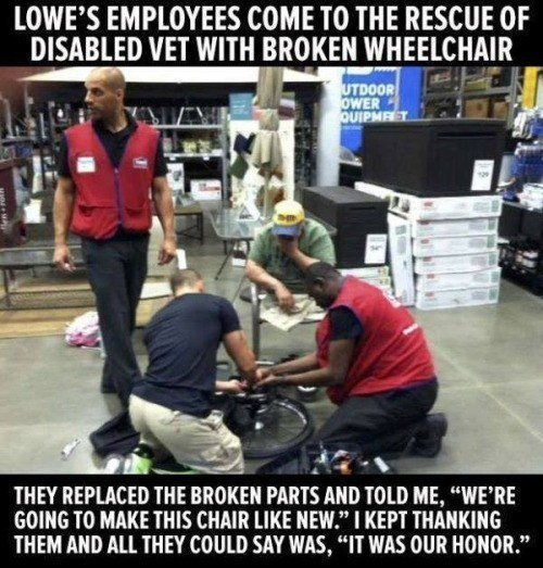 Employees Fix Wheelchair