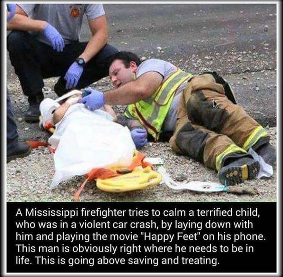 Firefighter Comforts Child