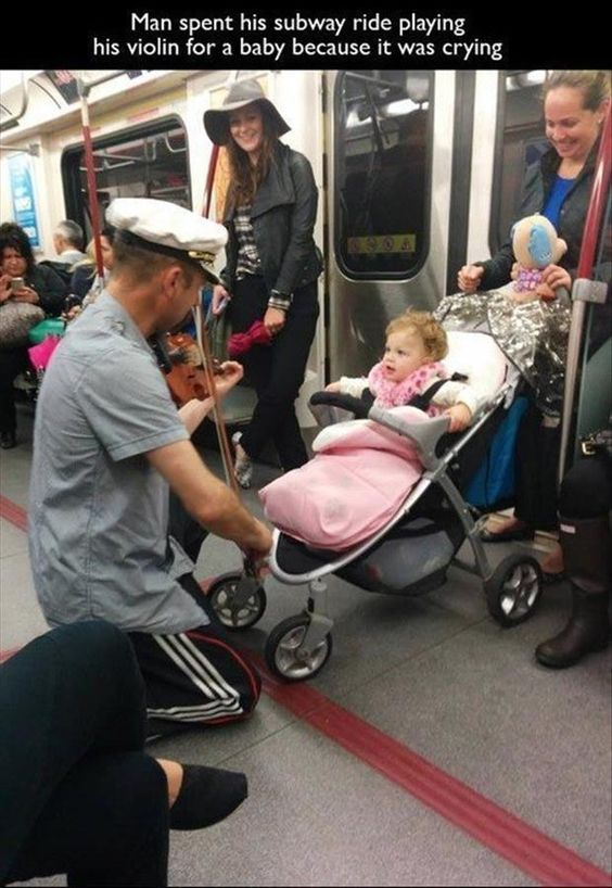 Man Plays Violin for Little Girl