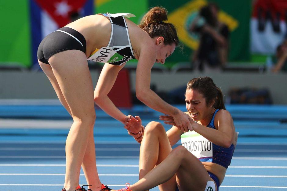 Nikki Hamblin helps Abbey D'Agostino in 5000.jpg