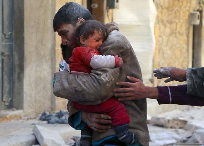 Syrian Siblings In Rubble