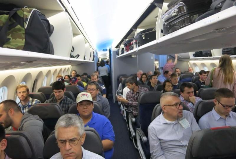 Flier Sues after Being Stuck