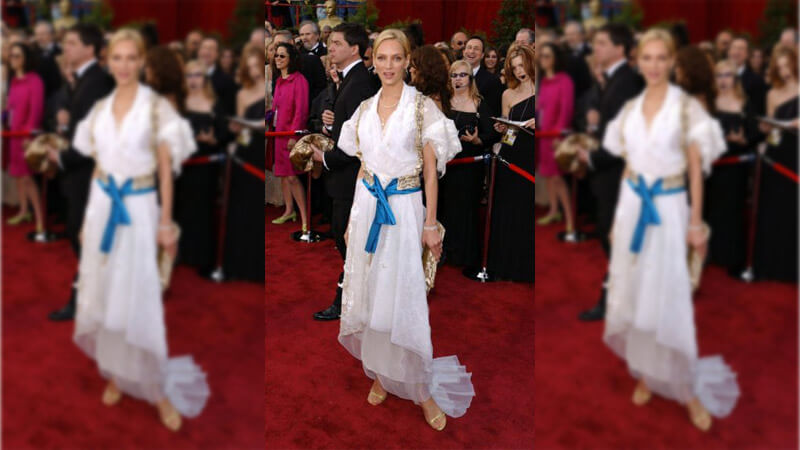 Uma Thurman Gets Lost in Fabric