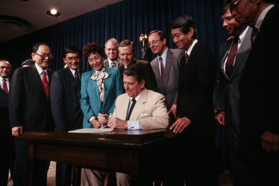 reagan signing bill.jpg